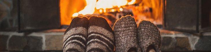 warm socked feet in front of a fire