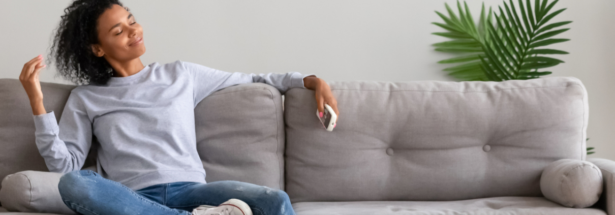 woman relaxing on the couch with the ac on
