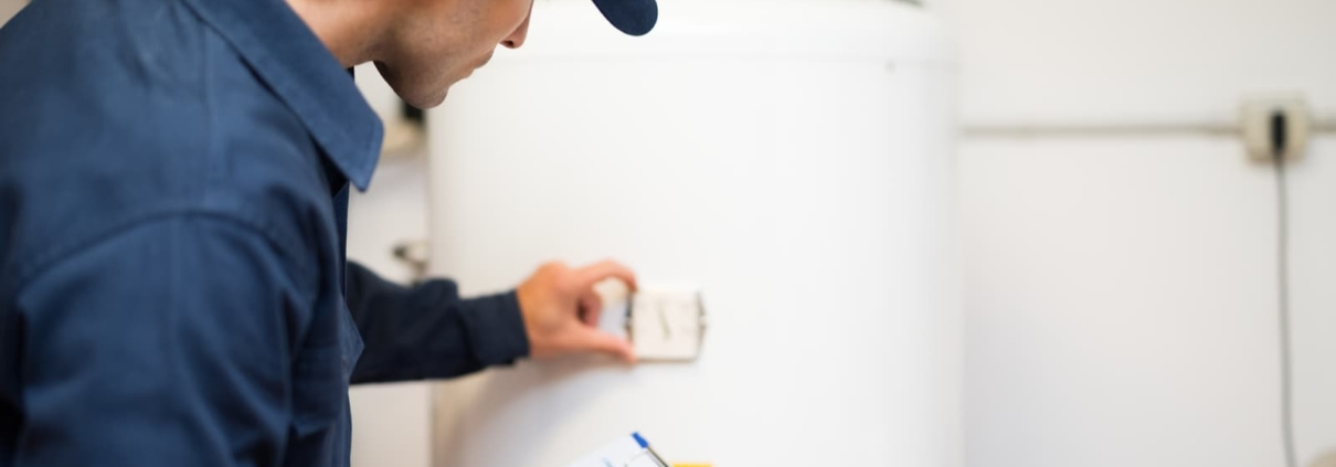 technician evaluating a hot water heater
